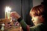 Luka lighting Menorah Dec2009