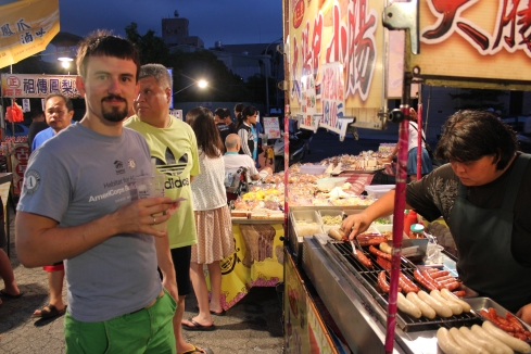 Jer getting some seriously awesome sweet Taiwanese sausage at a night market in Taichung, July 2013.